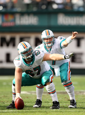 OAKLAND, CA - NOVEMBER 28:  Chad Henne #7 and Joe Berger #67 of the Miami Dolphins in action against the Oakland Raiders at Oakland-Alameda County Coliseum on November 28, 2010 in Oakland, California.  (Photo by Ezra Shaw/Getty Images)