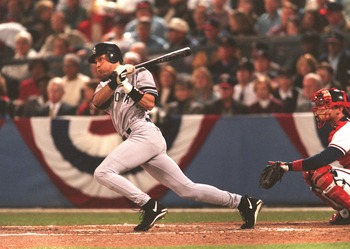 24 Oct 1996: Batter Derek Jeter of New York Yankees makes contact with a pitch during the Yankees 1-0 win over the Atlanta Braves in Game 5 of the World Series at Fulton County Stadium in Atlanta, Georgia.
