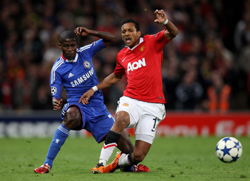 MANCHESTER, ENGLAND - APRIL 12:  Ramires of Chelsea brings down Nani of Manchester United and is subsequently sent off during the UEFA Champions League Quarter Final second leg match between Manchester United and Chelsea at Old Trafford on April 12, 2011