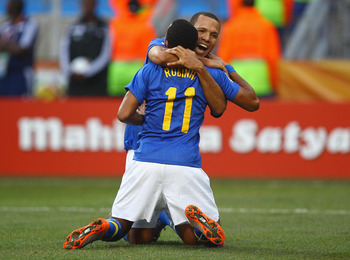 PORT ELIZABETH, SOUTH AFRICA - JULY 02:  Luis Fabiano congratulates Robinho of Brazil after he scored the opening goal during the 2010 FIFA World Cup South Africa Quarter Final match between Netherlands and Brazil at Nelson Mandela Bay Stadium on July 2,