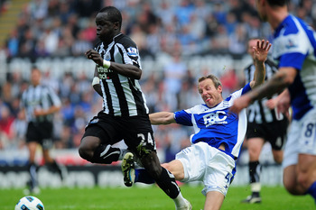 NEWCASTLE UPON TYNE, ENGLAND - MAY 07:  Birmingham player Lee Bowyer (C) fouls Chiek Tiote of Newcastle during the Barclays Premier League game between Newcastle United and Birmingham City at St James' Park on May 7, 2011 in Newcastle upon Tyne, England.