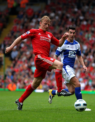LIVERPOOL, ENGLAND - APRIL 23:  Dirk Kuyt of Liverpool wins the ball during the Barclays Premier League match between Liverpool and Birmingham City at Anfield on April 23, 2011 in Liverpool, England.  (Photo by Clive Brunskill/Getty Images)
