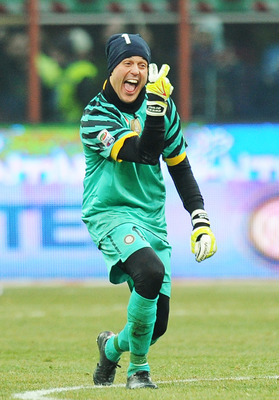 MILAN, ITALY - JANUARY 30: Julio Cesar goalkeeper of Intenazionale  celebrates after winning the Serie A match between FC Internazionale Milano and US Citta di Palermo at Stadio Giuseppe Meazza on January 30, 2011 in Milan, Italy.  (Photo by Tullio M. Pug