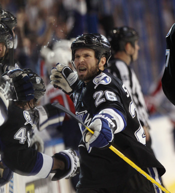 Martin St. Louis clinched the sweep of the Capitals with a late goal in Game Four.