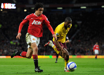 MANCHESTER, ENGLAND - MARCH 12:  Rafael Da Silva of Manchester United and Abou Diaby of Arsenal battle for the ball during the FA Cup sponsored by E.On Sixth Round match between Manchester United and Arsenal at Old Trafford on March 12, 2011 in Manchester