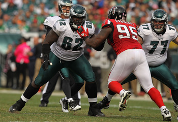 PHILADELPHIA - OCTOBER 17: Max Jean Gilles #62 of the Philadelphia Eagles in action against Jonathan Babineaux #95 of the Atlanta Falcons during their game at Lincoln Financial Field on October 17, 2010 in Philadelphia, Pennsylvania.  (Photo by Al Bello/G