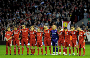 LIVERPOOL, ENGLAND - APRIL 11:  The Liverpool  players acknowledge a minutes silence in memory of the victims of the Hillsborough disaster prior to the Barclays Premier League match between Liverpool and Manchester City at Anfield on April 11, 2011 in Liv