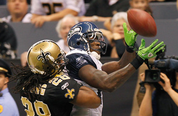 NEW ORLEANS - NOVEMBER 21:  Mike Williams #17 of the Seattle Seahawks fails to pull in this touchdown reception against Usama Young #28 of the New Orleans Saints at Louisiana Superdome on November 21, 2010 in New Orleans, Louisiana.  (Photo by Kevin C. Co