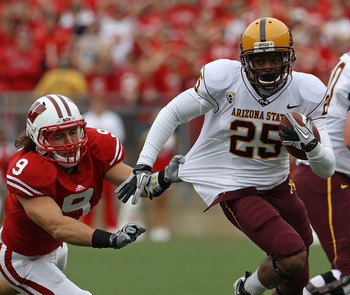 MADISON, WI - SEPTEMBER 18: Deantre Lewis #25 of the Arizona State Sun Devils tries to break away from Blake Sorensen #9 of the Wisconsin Badgers at Camp Randall Stadium on September 18, 2010 in Madison, Wisconsin. (Photo by Jonathan Daniel/Getty Images)