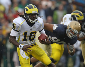 SOUTH BEND, IN - SEPTEMBER 11: Denard Robinson #16 of the Michigan Wolverines runs past Ethan Johnson #90 of the Notre Dame Fighting Irish at Notre Dame Stadium on September 11, 2010 in South Bend, Indiana. Michigan defeated Notre Dame 28-24. (Photo by Jo