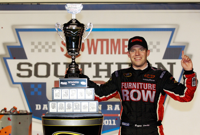 DARLINGTON, SC - MAY 07:  Regan Smith, driver of the #78 Furniture Row Companies Chevrolet, celebrates with in Victory Lane after winning the NASCAR Sprint Cup Series SHOWTIME Southern 500 at Darlington Raceway on May 7, 2011 in Darlington, South Carolina