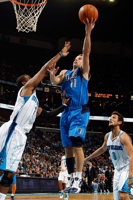 NEW ORLEANS - NOVEMBER 17:  Jose Barea #11 of the Dallas Mavericks shoots the ball  over Chris Paul #3 of the New Orleans Hornets at the New Orleans Arena on November 17, 2010 in New Orleans, Louisiana.  The Hornets defeated the Mavericks 99-97.  NOTE TO