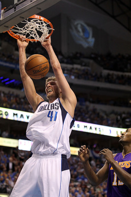 DALLAS, TX - MAY 08:  Forward Dirk Nowitzki #41 of the Dallas Mavericks gets the slam dunk against Ron Artest #15 of the Los Angeles Lakers in Game Four of the Western Conference Semifinals during the 2011 NBA Playoffs on May 8, 2011 at American Airlines