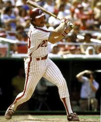 SAN DIEGO - 1987:  Mike Schmidt #20 of the Philadelphia Phillies watches the flight of the ball after a hit during a 1987 season game against the Padres at Jack Murphy Stadium in San Diego, California. (Photo by Stephen Dunn/Getty Images)