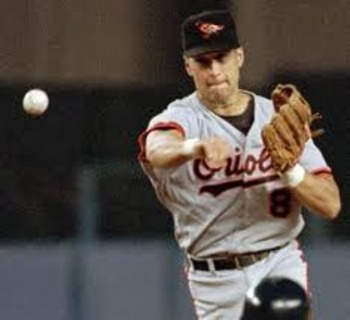 06 Oct 2001:  Cal Ripken Jr. #8 of the Baltimore Orioles throws to first for a put-out in the final game of his career at Camden Yards in Baltimore, Maryland. The Red Sox beat the Orioles 5-1. <DIGITAL IMAGE>    Mandatory Credit: Ezra Shaw/ALLSPORT