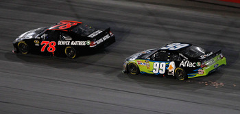 DARLINGTON, SC - MAY 07: Regan Smith, driver of the #78 Furniture Row Companies Chevrolet, leads Carl Edwards, driver of the #99 Aflac Ford, in the final lap of the NASCAR Sprint Cup Series SHOWTIME Southern 500 at Darlington Raceway on May 7, 2011 in Dar