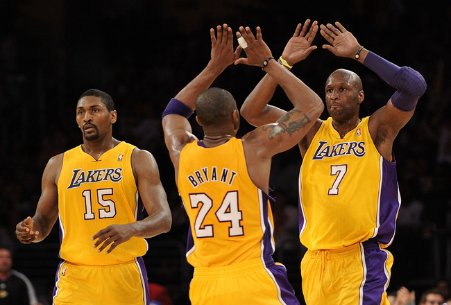 LOS ANGELES, CA - APRIL 20:  (R-L) Lamar Odom #7 and Kobe Bryant #24 of the Los Angeles Lakers celebrate on the court as they stand next to teammate Ron Artest #15 while taking on the New Orleans Hornets in Game Two of the Western Conference Quarterfinals