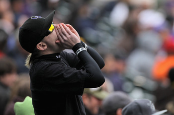 DENVER, CO - MAY 01:  A fan cheers on the Colorado Rockies against the Pittsburgh Pirates at Coors Field on May 1, 2011 in Denver, Colorado. The Pirates defeated the Rockies 8-4.  (Photo by Doug Pensinger/Getty Images)