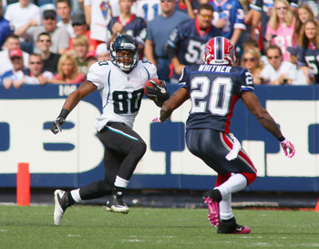 ORCHARD PARK, NY - OCTOBER 10:  Mike Thomas #80 of the Jacksonville Jaguars runs toward Donte Whitner #20  of the Buffalo Bills  at Ralph Wilson Stadium on October 10, 2010 in Orchard Park, New York. Jacksonville won 36-26.  (Photo by Rick Stewart/Getty I