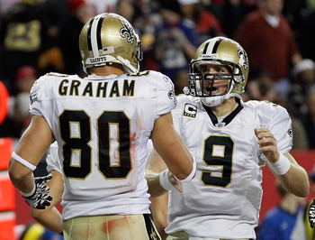 ATLANTA, GA - DECEMBER 27:  Quarterback Drew Brees #9 of the New Orleans Saints celebrates a touchdown pass to Jimmy Graham #80 in the second half during the game against the Atlanta Falcons at the Georgia Dome on December 27, 2010 in Atlanta, Georgia.  (