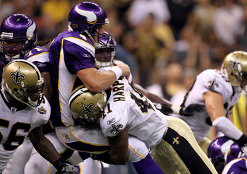 NEW ORLEANS - SEPTEMBER 09:  Quarterback Brett Favre #4 of the Minnesota Vikings takes a hard hit from Roman Harper #41 of the New Orleans Saints at Louisiana Superdome on September 9, 2010 in New Orleans, Louisiana.  (Photo by Ronald Martinez/Getty Image