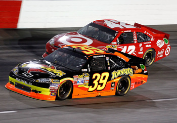 DARLINGTON, SC - MAY 07: Ryan Newman, driver of the #39 Tornados Chevrolet, races Juan Pablo Montoya, driver of the #42 Target Chevrolet, during the NASCAR Sprint Cup Series SHOWTIME Southern 500 at Darlington Raceway on May 7, 2011 in Darlington, South C