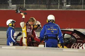 DARLINGTON, SC - MAY 07:  Clint Bowyer, driver of the #33 BB&T Chevrolet, throws his harness after crashing late in the race during the NASCAR Sprint Cup Series SHOWTIME Southern 500 at Darlington Raceway on May 7, 2011 in Darlington, South Carolina.  (Ph