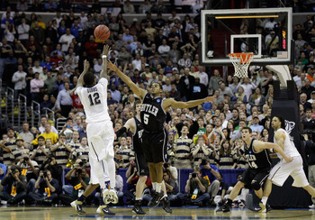 WASHINGTON - MARCH 19:  Ashton Gibbs #12 of the Pittsburgh Panthers puts up a shot over Ronald Nored #5 of the Butler Bulldogs during the third round of the 2011 NCAA men's basketball tournament at Verizon Center on March 19, 2011 in Washington, DC. Butle