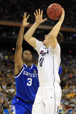 HOUSTON, TX - APRIL 02:  Tyler Olander #10 of the Connecticut Huskies goes to the hoop against Terrence Jones #3 of the Kentucky Wildcats during the National Semifinal game of the 2011 NCAA Division I Men's Basketball Championship at Reliant Stadium on Ap