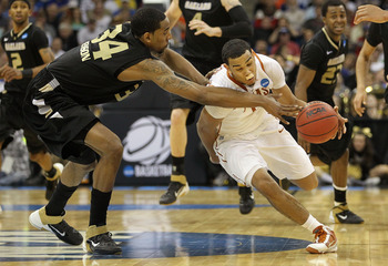 TULSA, OK - MARCH 18:  Cory Joseph #5 of the Texas Longhorns drives with the ball against Keith Benson #34 of the Oakland Golden Grizzlies during the second round of the 2011 NCAA men's basketball tournament at BOK Center on March 18, 2011 in Tulsa, Oklah