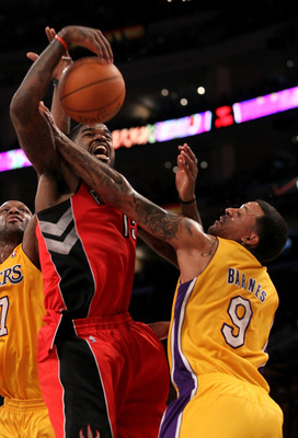 LOS ANGELES, CA - NOVEMBER 05:  Amir Johnson #15 of  the Toronto Raptors battles for the ball with Matt Barnes #9 of the Los Angeles Lakers at Staples Center on November 5, 2010 in Los Angeles, California.  The Lakers won 108-102.   NOTE TO USER: User exp