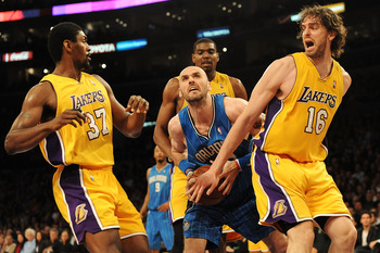 LOS ANGELES, CA - JANUARY 18:  Marcin Gortat #13 of the Orlando Magic goes to the basket against Ron Artest #37, Andrew Bynum #17 and Pau Gasol #16 of the Los Angeles Lakers in the third quarter during the game on January 18, 2010 at Staples Center in Los