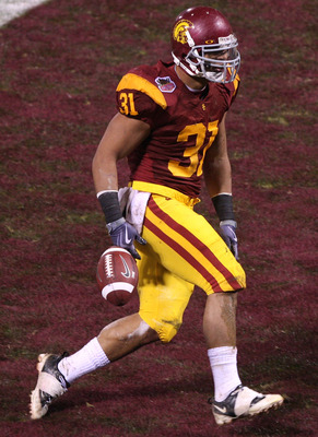 SAN FRANCISCO - DECEMBER 26: Stanley Havili #31 of the USC Trojans celebrates after a touchdown in the first quarter against the Boston College Eagles during the 2009 Emerald Bowl at AT&T Park on December 26, 2009 in San Francisco, California. (Photo by J