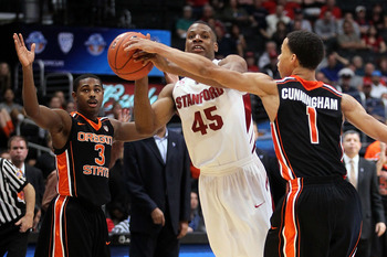 LOS ANGELES, CA - MARCH 09:  Jeremy Green #45 of the Stanford Cardinal has his last second shot attempt blocked by Jared Cunningham #1 of the Oregon State Beavers as the Cardinal lost to the Beavers 69-67 in the first round of the 2011 Pacific Life Pac-10