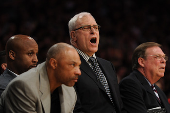LOS ANGELES, CA - APRIL 26:  (2nd R) Head coach Phil Jackson of the Los Angeles Lakers reacts as he sits between assistant coaches (L) Jim Cleamons, (2nd L) Brian Shaw and (R) Frank Hamblen in the second quarter while taking on the New Orleans Hornets in