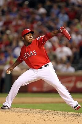 ARLINGTON, TX - MAY 07:  Pitcher Neftali Feliz #30 of the Texas Rangers throws against the New York Yankees at Rangers Ballpark in Arlington on May 7, 2011 in Arlington, Texas.  (Photo by Ronald Martinez/Getty Images)