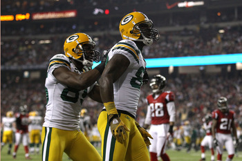 ATLANTA, GA - JANUARY 15:  James Jones #89 (R) and Greg Jennings #85 of the Green Bay Packers celebrate after Jones scored a 20-yard touchdown in the second quarter against the Atlanta Falcons during their 2011 NFC divisional playoff game at Georgia Dome