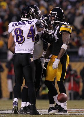 PITTSBURGH, PA - JANUARY 15:  Wide receiver T.J. Houshmandzadeh #84 of the Baltimore Ravens and cornerback Ike Taylor #24 of the Pittsburgh Steelers are separated after Houshmandzadeh was head butted by Taylor in the first quarter of the AFC Divisional Pl