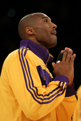 LOS ANGELES, CA - OCTOBER 26:  Kobe Bryant #24 of the Los Angeles Lakers reacts as the 2009-2010 Championship Banner is unveiled during a ceremony prior to their opening night game against the Houston Rockets at Staples Center on October 26, 2010 in Los A