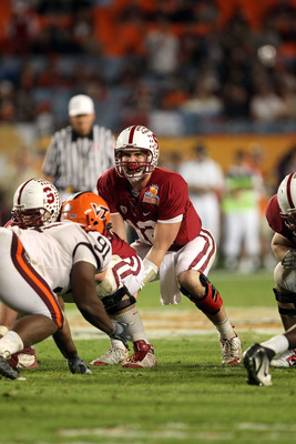 MIAMI, FL - JANUARY 03:  Andrew Luck #12 of the Stanford Cardinal callls signals out as he stands under center against the Virginia Tech Hokies during the 2011 Discover Orange Bowl at Sun Life Stadium on January 3, 2011 in Miami, Florida. Stanford won 40-