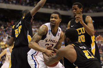 SAN ANTONIO, TX - MARCH 27:  Marcus Morris #22 of the Kansas Jayhawks handles the ball against Ed Nixon #50, Jamie Skeen #21 and Bradford Burgess #20 of the Virginia Commonwealth Rams during the southwest regional final of the 2011 NCAA men's basketball t