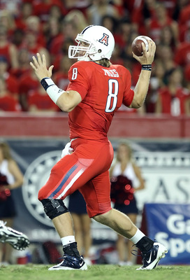 TUCSON, AZ - SEPTEMBER 18:  Quarterback Nick Foles #8 of the Arizona Wildcats drops back to pass during the college football game against the Iowa Hawkeyes at Arizona Stadium on September 18, 2010 in Tucson, Arizona.  (Photo by Christian Petersen/Getty Im