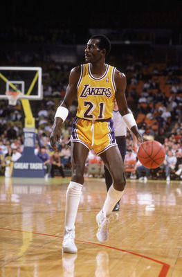 LOS ANGELES - 1987:  Michael Cooper #21 of the Los Angeles Lakers dribbles the ball during an NBA game at the Great Western Forum in Los Angeles, California in 1987. (Photo by: Rick Stewart/Getty Images)