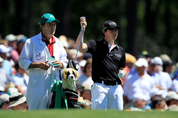 AUGUSTA, GA - APRIL 07:  Rory McIlroy of Northern Ireland pulls a club alongside his caddie JP Fitzgerald on the 12th hole during the first round of the 2011 Masters Tournament at Augusta National Golf Club on April 7, 2011 in Augusta, Georgia.  (Photo by