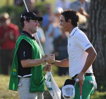 CASTELLON DE LA PLANA, SPAIN - OCTOBER 24:  Matteo Manassero of Italy celebrates with his caddie, Ryan McGuigan on the 18th hole during the final round of the Castello Masters Costa Azahar at the Club de Campo del Mediterraneo on October 24, 2010 in Caste