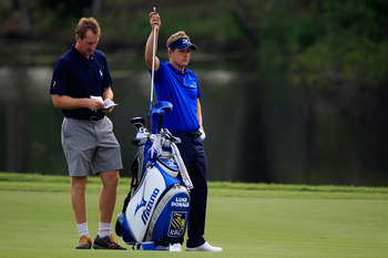 PONTE VEDRA BEACH, FL - MAY 11:  Luke Donald of England (R) pulls a club from his bag alongside caddie John McLaren (L) during a practice round prior to the start of THE PLAYERS Championship held at THE PLAYERS Stadium course at TPC Sawgrass on May 11, 20