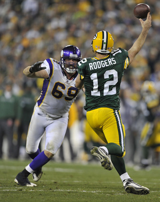 GREEN BAY, WI - OCTOBER 24:  Jared Allen #69 of the Minnesota Vikings pressures Aaron Rodgers #12 of the Green Bay Packers at Lambeau Field on October 24, 2010 in Green Bay, Wisconsin. (Photo by Jim Prisching/Getty Images)