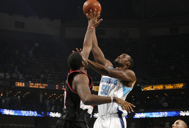 NEW ORLEANS - NOVEMBER 13:  Emeka Okafor #50 of the New Orleans Hornets puts up a shot against Greg Oden #52 of the Portland Trail Blazers during the game at New Orleans Arena on November 13, 2009 in New Orleans, Louisiana.  NOTE TO USER: User expressly a