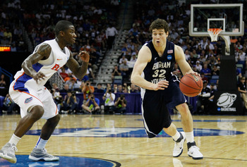 NEW ORLEANS, LA - MARCH 24:  Jimmer Fredette #32 of the Brigham Young Cougars drives past Kenny Boynton #1 of the Florida Gators during the Southeast regional of the 2011 NCAA men's basketball tournament at New Orleans Arena on March 24, 2011 in New Orlea