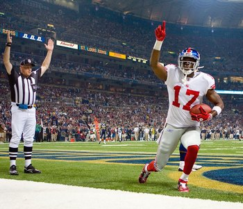 ST. LOUIS, MO - SEPTEMBER 14: Plaxico Buress #17 of the New York Giants celebrates a touchdown against the St. Louis Rams at the Edward Jones Dome on September 14, 2008 in St. Louis, Missouri. (Photo by Dilip Vishwanat/Getty Images)